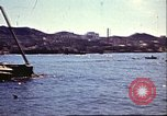Image of Damaged boats and buildings on coast in World War II North Africa, 1942, second 7 stock footage video 65675065261