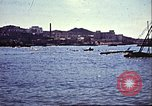 Image of Damaged boats and buildings on coast in World War II North Africa, 1942, second 9 stock footage video 65675065261