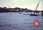 Image of Damaged boats and buildings on coast in World War II North Africa, 1942, second 10 stock footage video 65675065261