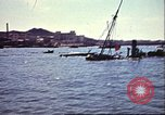 Image of Damaged boats and buildings on coast in World War II North Africa, 1942, second 11 stock footage video 65675065261