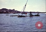 Image of Damaged boats and buildings on coast in World War II North Africa, 1942, second 12 stock footage video 65675065261