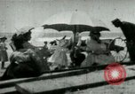 Image of Fashionably dressed women Coney Island New York USA, 1898, second 2 stock footage video 65675065290