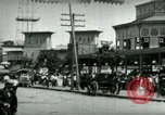 Image of street scene in Coney Island Coney Island New York USA, 1898, second 4 stock footage video 65675065292
