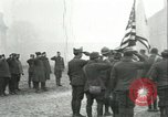 Image of U.S. troops raise flag on radio tower celebrating Armistice France, 1918, second 10 stock footage video 65675065322