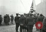 Image of U.S. troops raise flag on radio tower celebrating Armistice France, 1918, second 11 stock footage video 65675065322