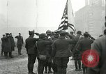 Image of U.S. troops raise flag on radio tower celebrating Armistice France, 1918, second 12 stock footage video 65675065322