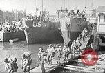 Image of US troops in landing craft  ferried to transport ships Weymouth England, 1944, second 8 stock footage video 65675065479