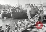 Image of US troops in landing craft  ferried to transport ships Weymouth England, 1944, second 9 stock footage video 65675065479
