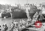 Image of US troops in landing craft  ferried to transport ships Weymouth England, 1944, second 10 stock footage video 65675065479