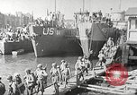 Image of US troops in landing craft  ferried to transport ships Weymouth England, 1944, second 11 stock footage video 65675065479