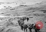 Image of American troop reinforcements and war materiel landing on beachhead Normandy France, 1944, second 1 stock footage video 65675065484