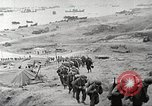 Image of U.S. reinforcements and war materiel landing on beachhead Normandy France, 1944, second 2 stock footage video 65675065484