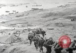 Image of U.S. reinforcements and war materiel landing on beachhead Normandy France, 1944, second 4 stock footage video 65675065484