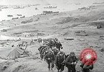 Image of U.S. reinforcements and war materiel landing on beachhead Normandy France, 1944, second 5 stock footage video 65675065484