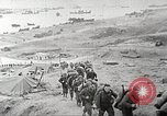 Image of American troop reinforcements and war materiel landing on beachhead Normandy France, 1944, second 6 stock footage video 65675065484
