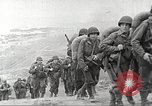Image of American troop reinforcements and war materiel landing on beachhead Normandy France, 1944, second 7 stock footage video 65675065484