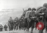 Image of U.S. reinforcements and war materiel landing on beachhead Normandy France, 1944, second 8 stock footage video 65675065484
