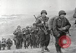 Image of U.S. reinforcements and war materiel landing on beachhead Normandy France, 1944, second 9 stock footage video 65675065484