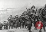 Image of U.S. reinforcements and war materiel landing on beachhead Normandy France, 1944, second 10 stock footage video 65675065484