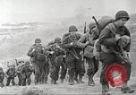 Image of U.S. reinforcements and war materiel landing on beachhead Normandy France, 1944, second 11 stock footage video 65675065484