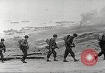 Image of U.S. reinforcements and war materiel landing on beachhead Normandy France, 1944, second 12 stock footage video 65675065484