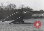 Image of ornithopter man with cardboard wings tries to fly United States USA, 1939, second 2 stock footage video 65675065522