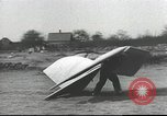 Image of ornithopter man with cardboard wings tries to fly United States USA, 1939, second 4 stock footage video 65675065522