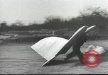 Image of ornithopter man with cardboard wings tries to fly United States USA, 1939, second 5 stock footage video 65675065522