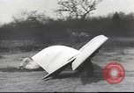 Image of ornithopter man with cardboard wings tries to fly United States USA, 1939, second 6 stock footage video 65675065522