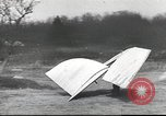 Image of ornithopter man with cardboard wings tries to fly United States USA, 1939, second 7 stock footage video 65675065522