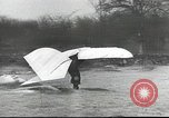 Image of ornithopter man with cardboard wings tries to fly United States USA, 1939, second 9 stock footage video 65675065522
