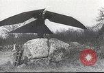 Image of ornithopter man with cardboard wings tries to fly United States USA, 1939, second 12 stock footage video 65675065522
