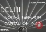 Image of riots Delhi India, 1948, second 4 stock footage video 65675065526