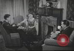 Image of U.S. Airman guest in British home United Kingdom, 1954, second 2 stock footage video 65675065566