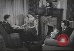 Image of U.S. Airman guest in British home United Kingdom, 1954, second 3 stock footage video 65675065566