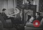 Image of U.S. Airman guest in British home United Kingdom, 1954, second 4 stock footage video 65675065566