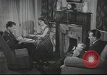 Image of U.S. Airman guest in British home United Kingdom, 1954, second 5 stock footage video 65675065566