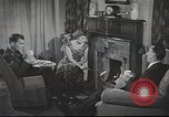 Image of U.S. Airman guest in British home United Kingdom, 1954, second 10 stock footage video 65675065566