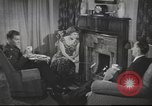 Image of U.S. Airman guest in British home United Kingdom, 1954, second 12 stock footage video 65675065566