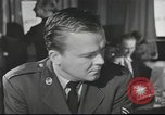 Image of Discussing politics in a Pub United Kingdom, 1954, second 3 stock footage video 65675065568