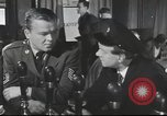 Image of Discussing politics in a Pub United Kingdom, 1954, second 8 stock footage video 65675065568