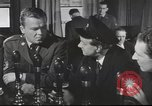 Image of Discussing politics in a Pub United Kingdom, 1954, second 9 stock footage video 65675065568