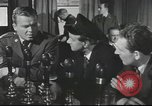 Image of Discussing politics in a Pub United Kingdom, 1954, second 10 stock footage video 65675065568