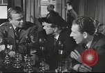 Image of Discussing politics in a Pub United Kingdom, 1954, second 12 stock footage video 65675065568