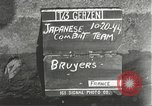 Image of Japanese-American infantrymen moving single-flle Bruyeres France, 1944, second 2 stock footage video 65675065586