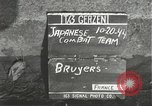 Image of Japanese-American infantrymen moving single-flle Bruyeres France, 1944, second 4 stock footage video 65675065586