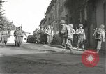 Image of Japanese-American infantrymen moving single-flle Bruyeres France, 1944, second 11 stock footage video 65675065586