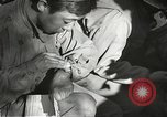 Image of Wounded of the 442nd Regimental Combat Team being treated Belmont France, 1944, second 5 stock footage video 65675065595