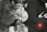 Image of Wounded of the 442nd Regimental Combat Team being treated Belmont France, 1944, second 6 stock footage video 65675065595