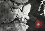 Image of Wounded of the 442nd Regimental Combat Team being treated Belmont France, 1944, second 8 stock footage video 65675065595